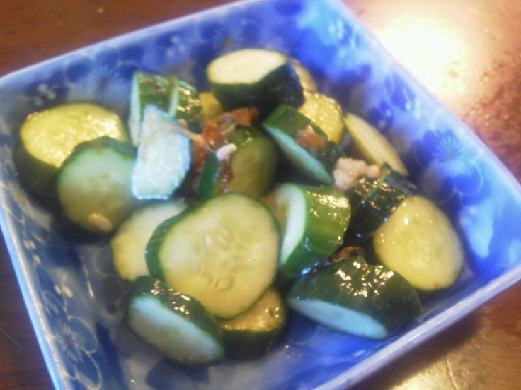 Korean dishes consisting of seasoned sliced cucumbers with vineger and sesame oil.