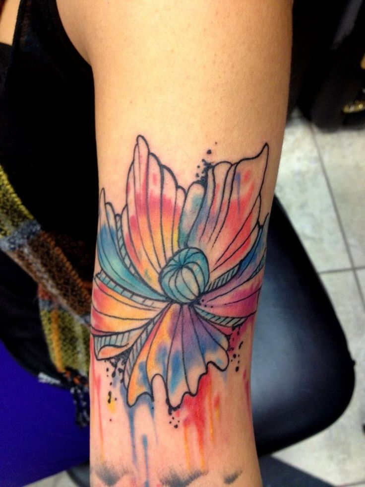 Abstract flower. i always love the tattoos that are like abstract watercolor look.. simply beautiful