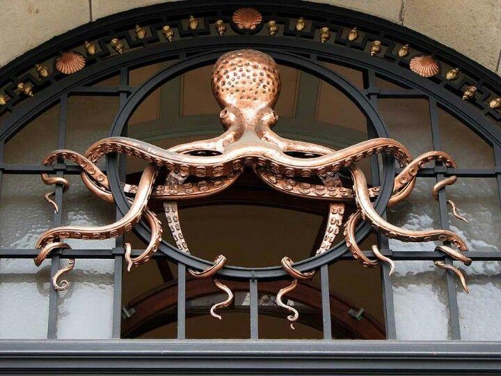 Octopus sculpture keeping watch over a door
