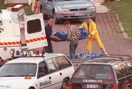Police remove the body of a victim killed in the Port Arthur massacre, 2 May 1996. SMH Picture by DALLAS KILPONEN