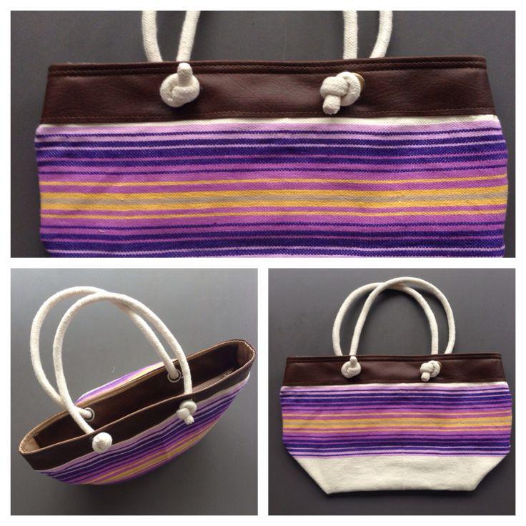 Descripción: Bolso cartera. Color: café, amarillo, violeta  Medida: 27x42cm