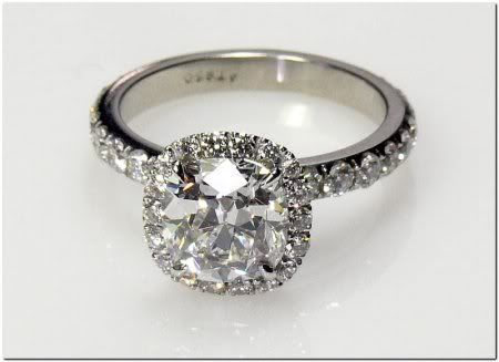 """Tacori - a """"cushion"""" shaped halo surrounding a round solitaire with no gaps in-between."""