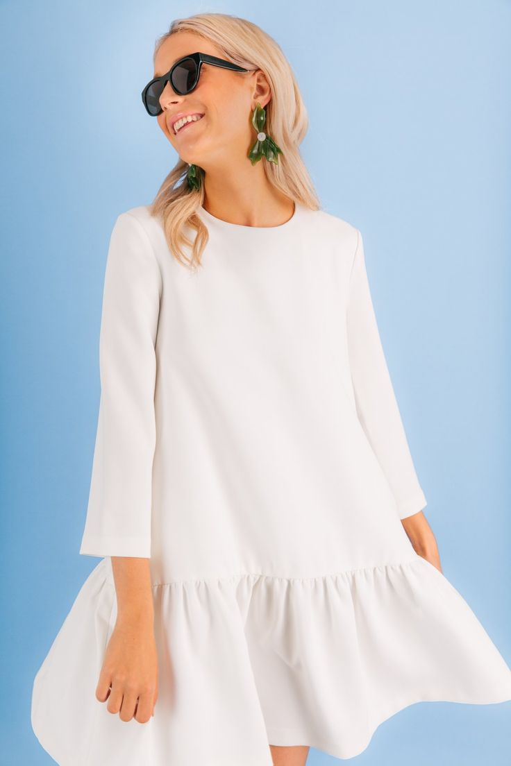 The November 10 - 2017. Number 5: Winter White. We've said it before, we'll say it again. We love to wear white int he winter. Add it to a dress with a flattering and easy silhouette. We're hooked.