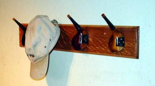 """Hat Rack - from """"25 New Uses for your Old Golf Clubs"""""""