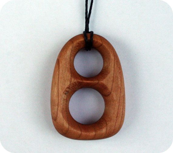 teething necklace for mom to wear--might have to think about this for Mr. L... he chews on everything close to his mouth!