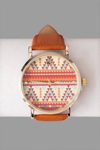 """We love the printed details of the Tulum Tribal Print Watch. This faux leather watch features a multicolored tribal print on the dial. Pair with a messenger bag and some sandals to finish your look!<br><br>  -.75"""" band width<br> -1.5"""" diameter (face) <br> -Battery operated<br> -Twist crown to set<br> -Imported<br>"""