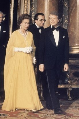 Queen Elizabeth II and U.S. Presidents Past and Present---When President Jimmy Carter met Queen Elizabeth II in London's Buckingham Palace on May 1, 1977 he declined to bow and instead went for a kiss. The queen was said to have held a grudge against Carter over the hello smooch for years. (AP Photo)