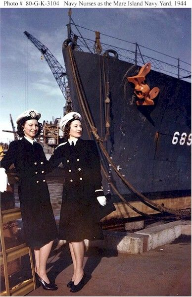 Ensign Dorothy Swallen, and Ensign Dora Eggleston At the Mare Island Navy Yard, California, circa late 1944. Both were Navy Nurses stationed at the Mare Island Naval Hospital. USS Wadleigh (DD-689) is in the background ~