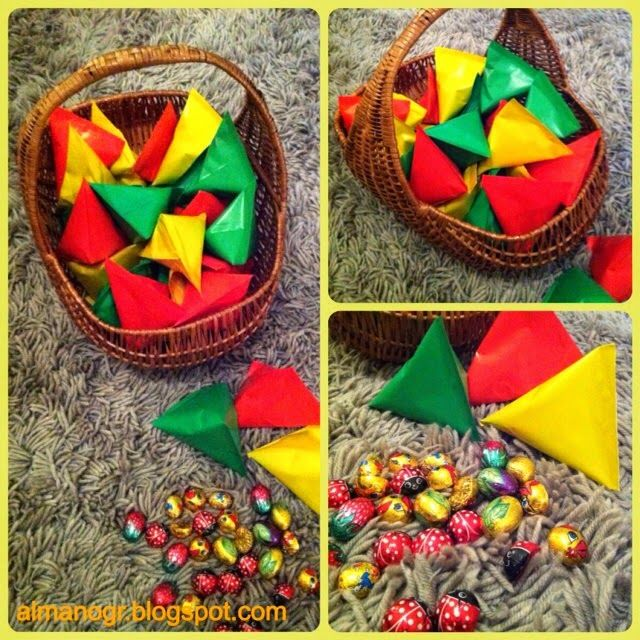 Gifts for kids. Colourful paper pyramids filled with chocolate eggs and ladybirds.