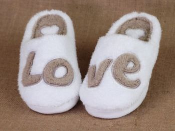 Classic, fluffy slippers with playful and inspiring messages.  If you ever question how completely loved you are in this world, simply glance down to your toes for a gentle reminder. And to remind him how much he is loved, a quick game of LOVE footsy should do the trick.  With a deep 'soul' of memory foam, our new LOVE slippers are the perfect gift for anyone who LOVES walking on clouds.
