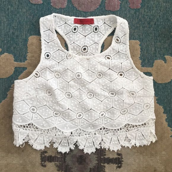 White eyelet crop top White eyelet crop top. Gently worn, looks brand new. Great for over a bathing suit or bandeau! Signatures Tops Crop Tops
