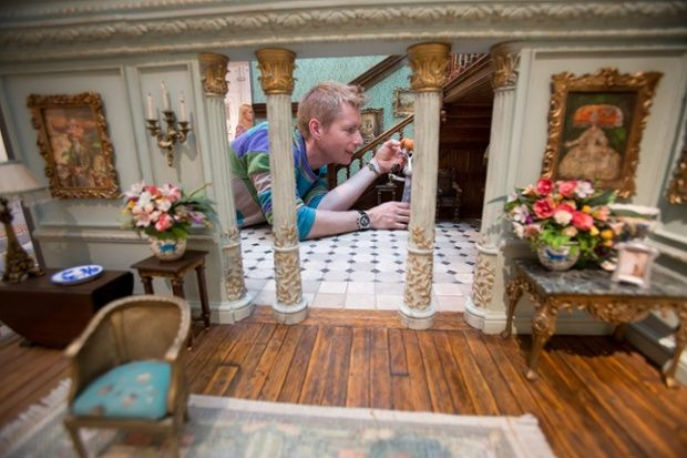Merlin Crossingham, creative director of Wallace and Gromit, makes some final adjustments to a set on display