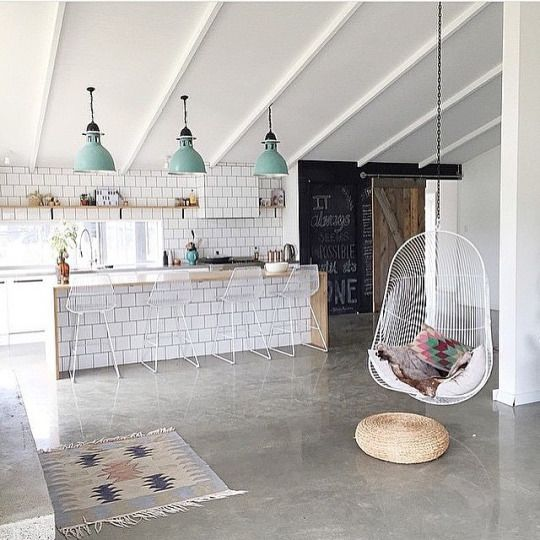 Hanging chair and white tile