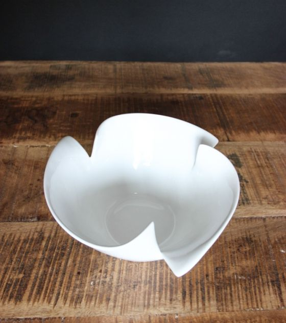This beautiful bowl is both decorative and functional. All Kika vessels are initially cast in a mould and then individually handshaped before fired. Purchase it or others from www.wave2africa.com