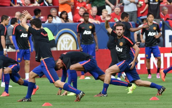 Manchester United's Juan Mata (R) warms up with teammates before a Champions Cup match against Inter Milan at FedEx Field in Landover, Maryland, on July 29, 2014.
