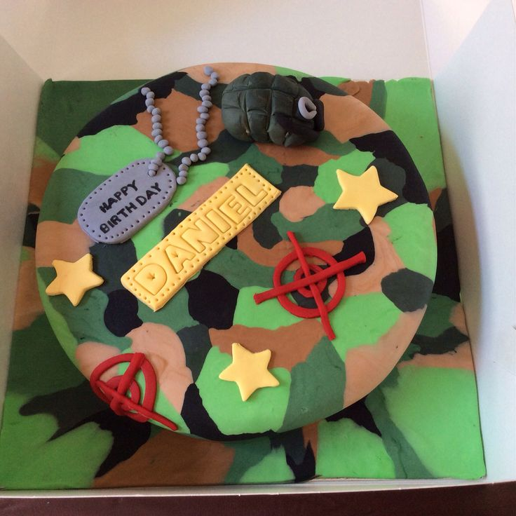 Camouflage cake with grenade topper