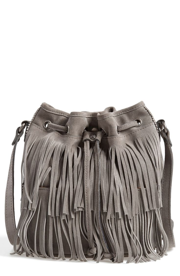 A lush, fringe bag is the perfect fall accessory. Can use this gray bucket bag for class,  or just out and about.
