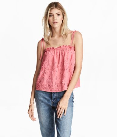 Pink/floral. Wide-cut top in woven viscose fabric with narrow tie shoulder straps, elastication at upper edge, and embroidered appliqués at front.