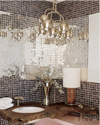Amazing Powder Room - matte and mirror finish tiles and vanity made from a slice of walnut root.  Elle Decor