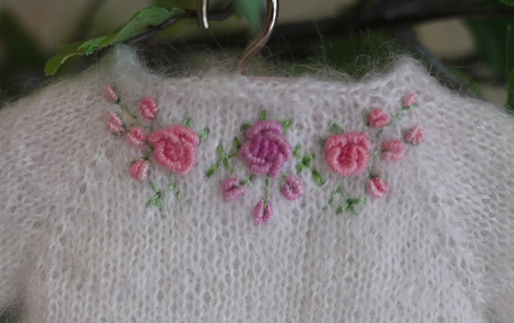 Embroidery on the back of a doll sweater.