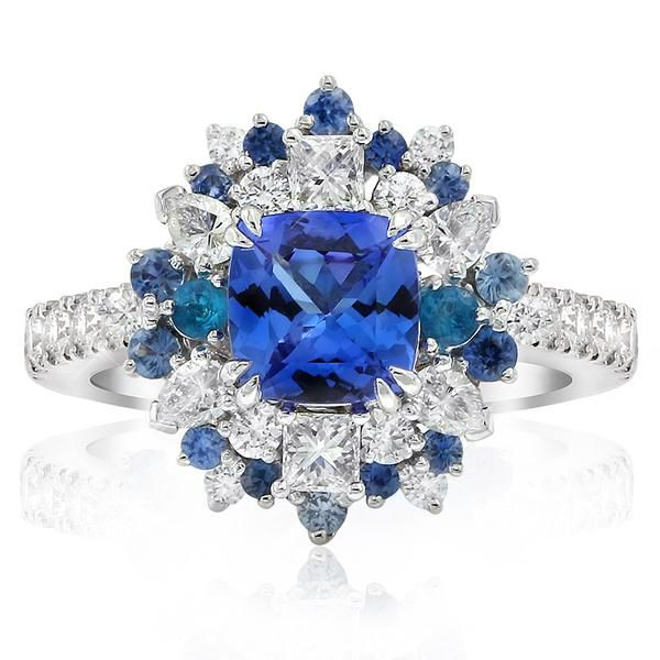 Be spellbound by this spectacular Cirque ring. Featuring a square cushion shaped tanzanite at its centre which is then accented by…