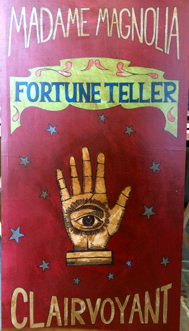 Vintage Fortune Teller Sign, painted onto ply board. She is a noble from a land that's borders no longer exist once called Mercia she fell in love at a carnival and secretly ran away. Now every carnival she marvels at what has changed and what has not.