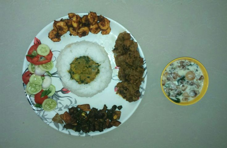 Odia non veg- veg mix plate - a cup of rice, sweet veg pulses, shrimps garlic fry, bitter guard poteto fry, ridge guard poteto in puppy seeds mix and curd bundi ( made out of Toor dal). so tasty....