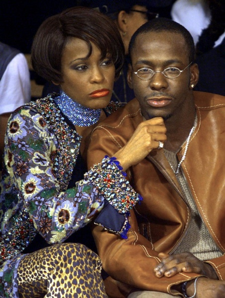Whitney Houston and Bobby Brown..  Aww how cute #PoutyFaceWhitney