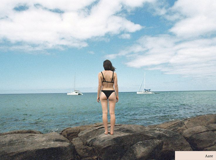 Nikia wearing the Aare Tamar top and Blyth bottoms in black. Available now - www.aareswim.com