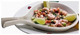Applebee´s Ceviche: Fresco ceviche de salmón, camarones, manzana, ají verde, cebolla, palta, pimientos rojos y verdes. Acompañado con nachos. Foto referencial.