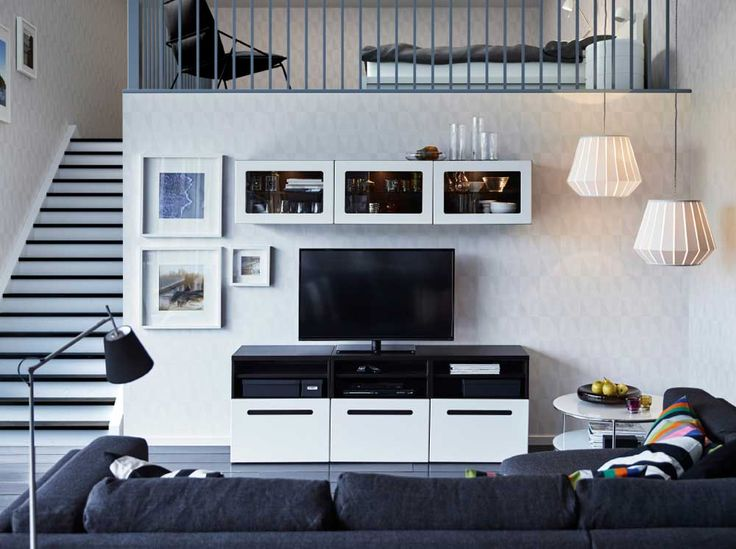 Cupboard Wall Pic with white color and black sofa for living room