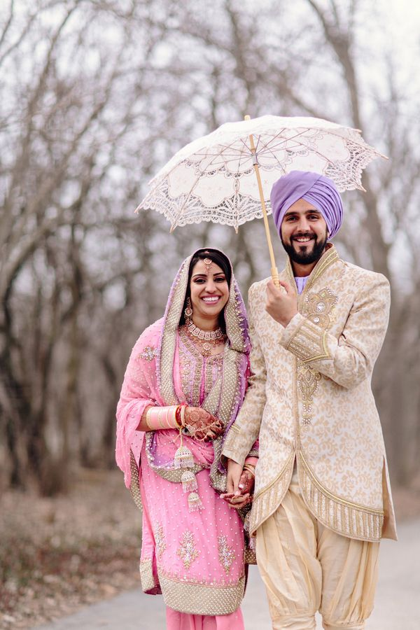 23a Indian Sikh wedding lace umbrella. Couple in pink purple salwar kameez, shervani and turban. More here - http://www.indianweddingsite.com/beautiful-illinois-fusion-sikh-wedding-almond-leaf-studios/