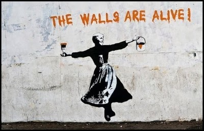 """ Les murs sont vivants."" / Street art. / By Banksy."