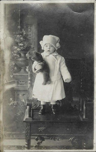 child with teddy bear: