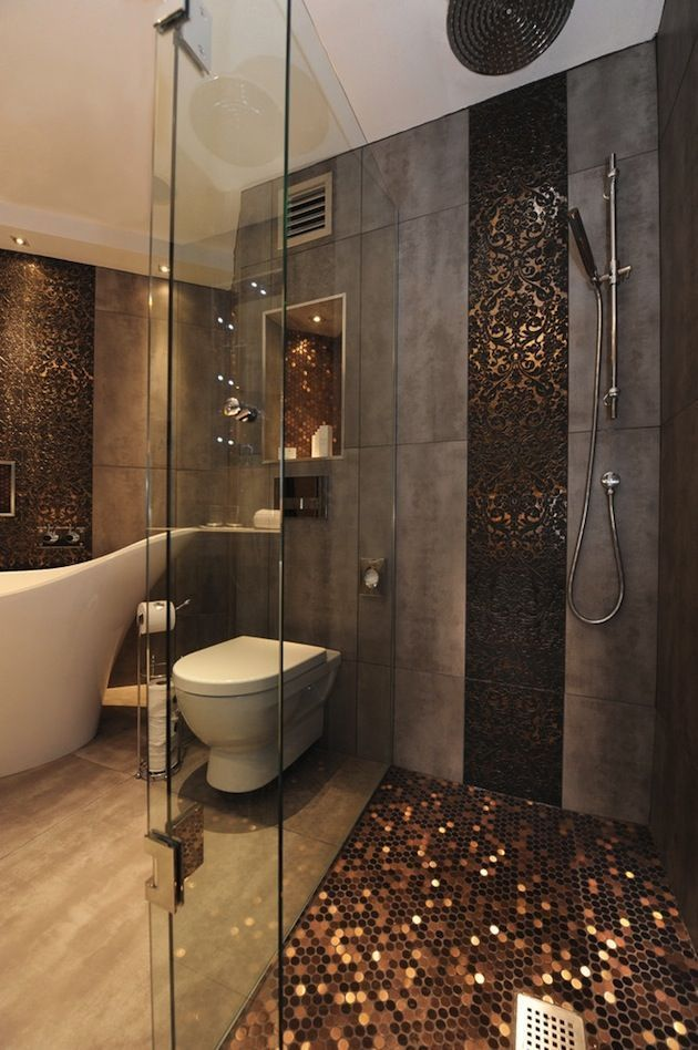 hmm copper pennies are a very inexpensive floor goes very well with the long slabs of stone tile open shower