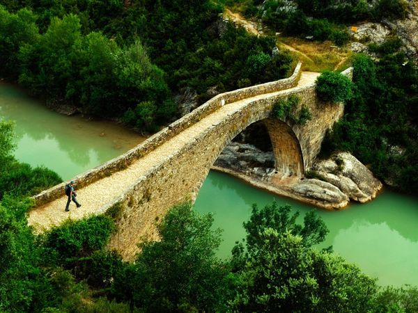 A small bridge spans a stream near the village of Rodellar in northern Spain, a region renowned for its climbing.