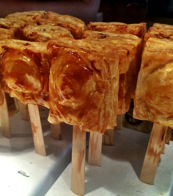 Puff pastry with duck confit and foie gras on a stick