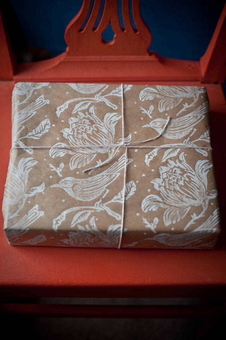 gift wrap made with patterned paint roller on brown paper