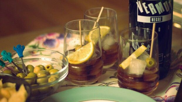Vermouth served Spanish-style with olive and orange