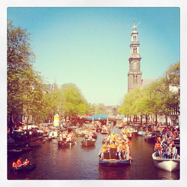 """Gorgeous queensday on the canals in Amsterdam!"" by amscityblog"