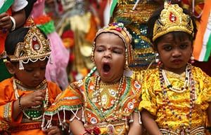 Children dressed as Krishna, a Hindu deity, wait to perform during the celebrations before the Janmashtami festival in Ajmer, India