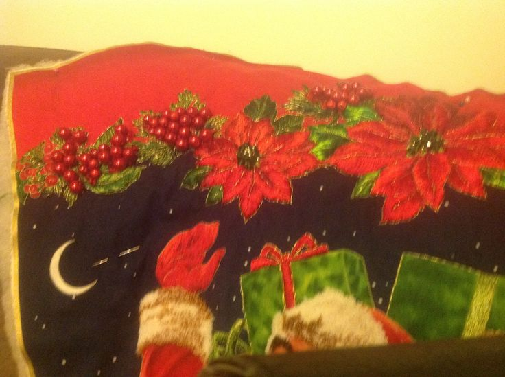 This is a picture showing a portion of a Christmas stocking panel I made for my daughter in law. It shows some beading, and a small section of his coat cuff, and hat..featuring my punch embroidery. I use a system from Mashas Russian punch embroidery . It creates a beautiful finish.