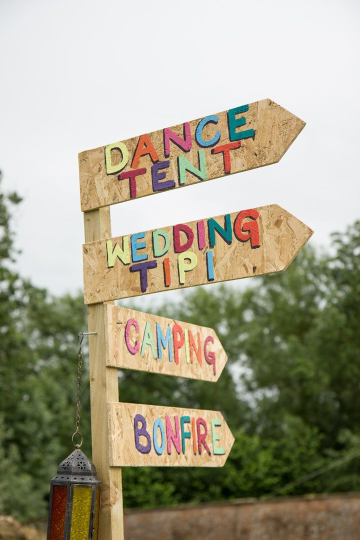Loving the signposting for Elizabeth and Paul's Festival Themed Wedding Weekender! By Blue Daisy Photography