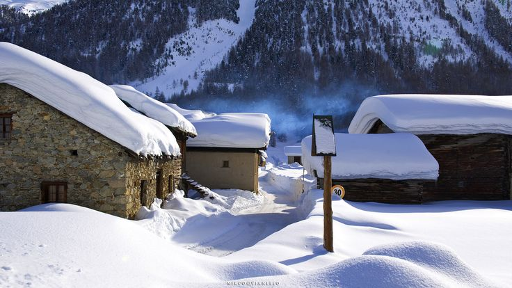 Don't rush - the first houses of Pont Lonc in Livigno