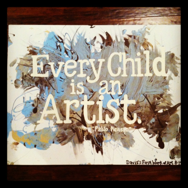 Toddler artwork with Pablo Picasso quote.