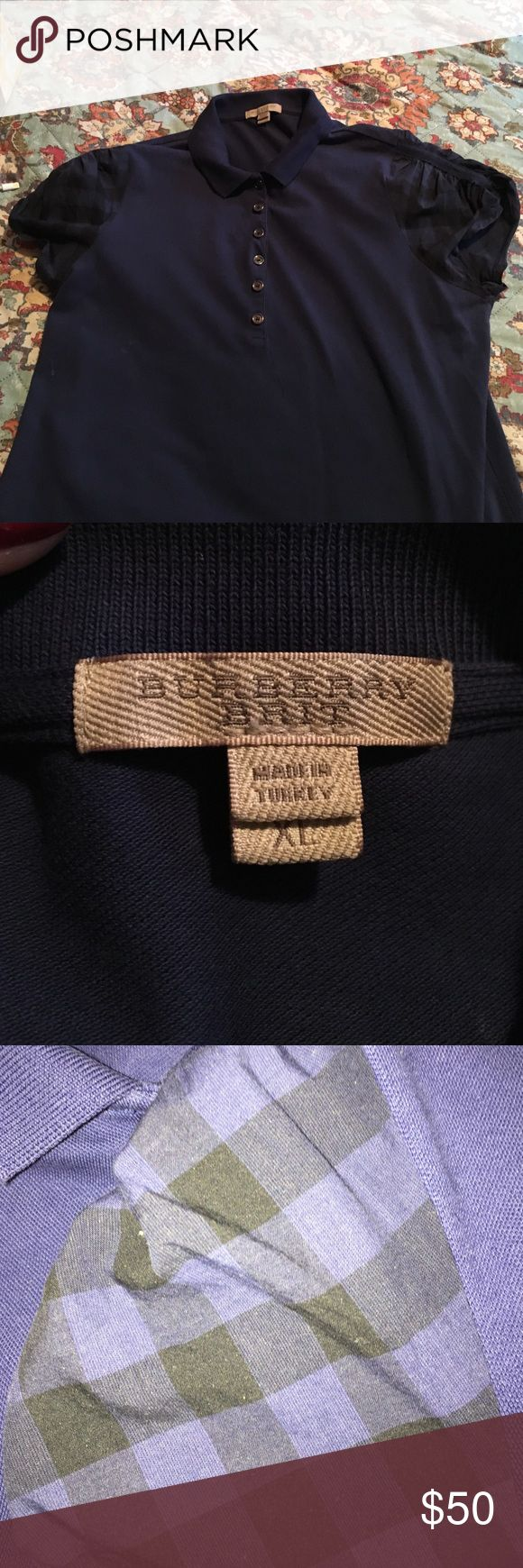Navy Blue Burberry Brit Polo Navy Blue Burberry Brit Polo. Each button says Burberry brit and nova check is featured on shoulders. Made in Turkey. I have another in green, comment if interested. Does not have Burberry logo on breast but is authentic Burberry Tops Blouses
