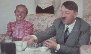 Relaxing with a cup of tea and sharing a joke with a crowd of admiring women - these are the rarely seen intimate portraits of Adolf Hitler at the height of his power.