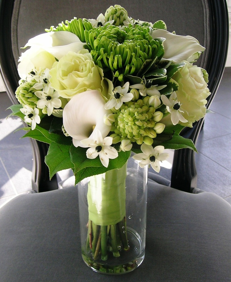 Wedding bouquet with green lisianthus, lime green mums, ornithogalum and white calla lilies.