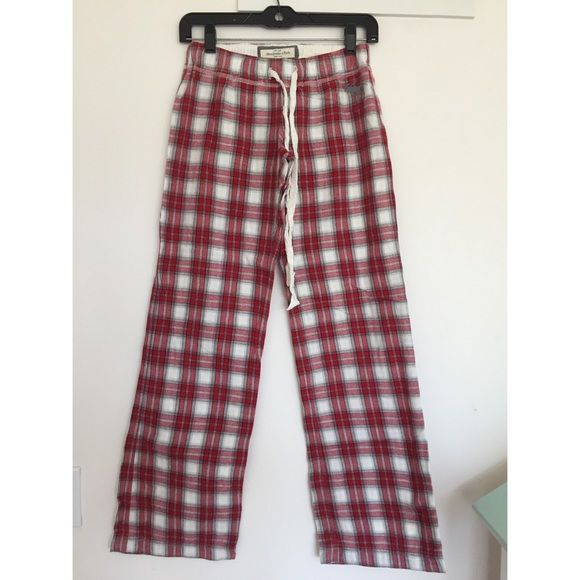 Abercrombie girls plaid sleep pants Red, gray and white plaid sleep pants from Abercrombie. Size small. They have a draw string which allows the waist to adjust. There's a small moose decal in gray on the left pant leg. Abercrombie & Fitch Pants