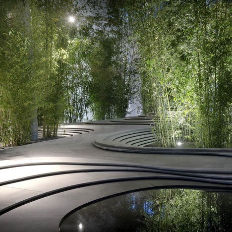 Stonescape by Kengo Kuma. Cascading stone strata formed a series of undulating curves around the room. Pools of water formed at some of the lowest levels, while others contained clusters of bamboo trees planted in gravel.
